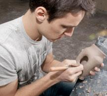 Art Studuent making a clay pot