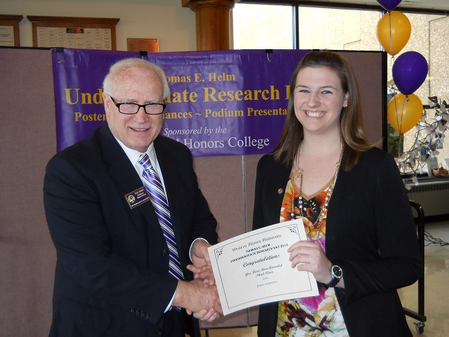 Kirsten Belisle receiving a URD award