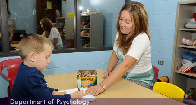 School psychology student working with client.