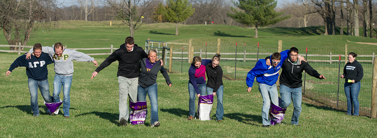 students in sack race