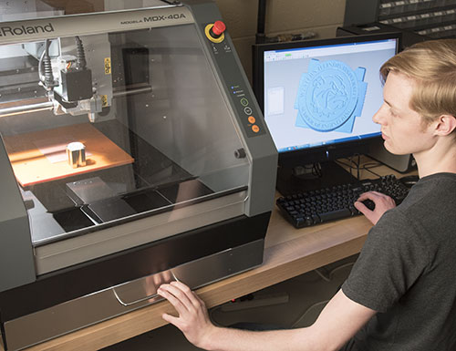 student working with a 3d printer