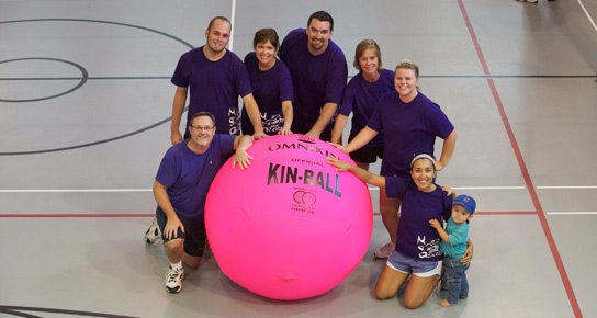 COAP employees with Big Pink Volleyball