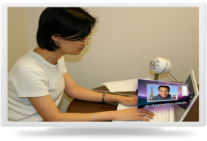 Image of Faculty   Member Videoconferencing with Student