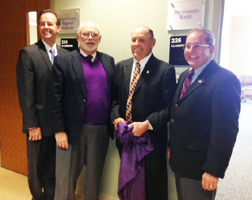 Pictured, from left are John Dubois, Geneseo Foundation Board of Managers; Gary Rowe, former WIU-QC director of development; Jim Lodico, president, WIU Foundation Board of Trustees and Todd Sieben, chairman, Board of Managers, Geneseo Foundation.