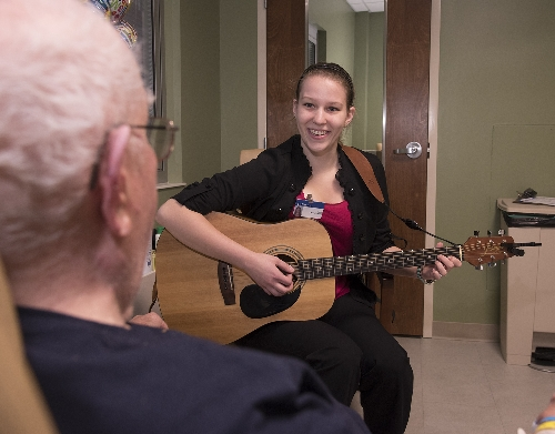 Brittany Robertson, a senior in the WIU music therapy program, works with a patient at MDH recently.