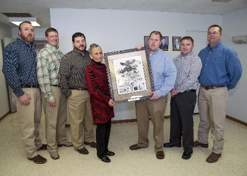 Members of the 1998-99 Western Illinois University Intercollegiate Livestock Judging Team and Bruce A. Engnell's widow, Victoria, at the ceremony the team members presented the commissioned artwork to the WIU School of Agriculture. From L to R: Andy Mench, Brett Beyers, Scott Davis, Victoria (''Vicki'') Engnell, Jared Frueh, Keith Ryan and Joe Driscoll.