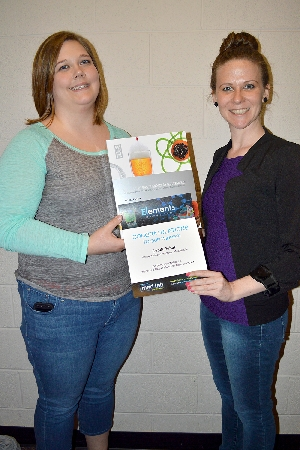 WIU junior Sandi Reber, left, accepts her prize from Sodexo Marketing Manager Anna Filson.