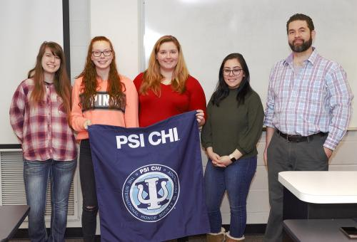 Pictured are Psi Chi officers Harley Spero (president), Josie Hasselbring (vice president), Laura Corbige (treasurer), Stephanie Lopez (secretary), along with Associate Professor Jonathan Hammersley (faculty advisor).