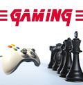 Photo of a video game controller facing chess pieces with the word gaming above them.