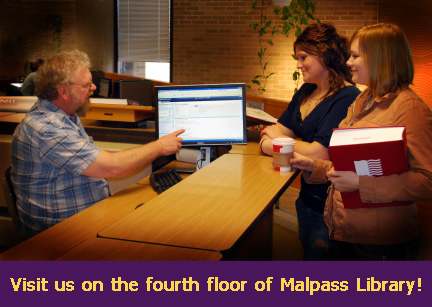 Photo of the Government, Legal, Spatial and Data Services Unit Desk on the fourth floor of the Malpass Library.
