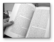 image of a hand holding a book with no bookmark