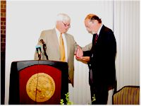 Macomb Mayor Mick Wisslead presents John Hallwas with Studs Terkel Award