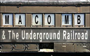 A train car with the words Macomb and the Underground Railroad on it.