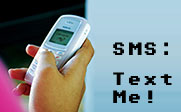 Image of a person texting on their cell phone with the text SMS: Text Me!