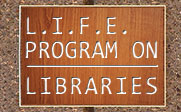 A wooden plaque on a cement wall with the text L.I.F.E. PROGRAM ON LIBRARIES