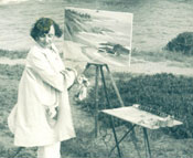 A photo of Joane Cromwell painting along the California coast, with her dog Caesar, circa 1940.