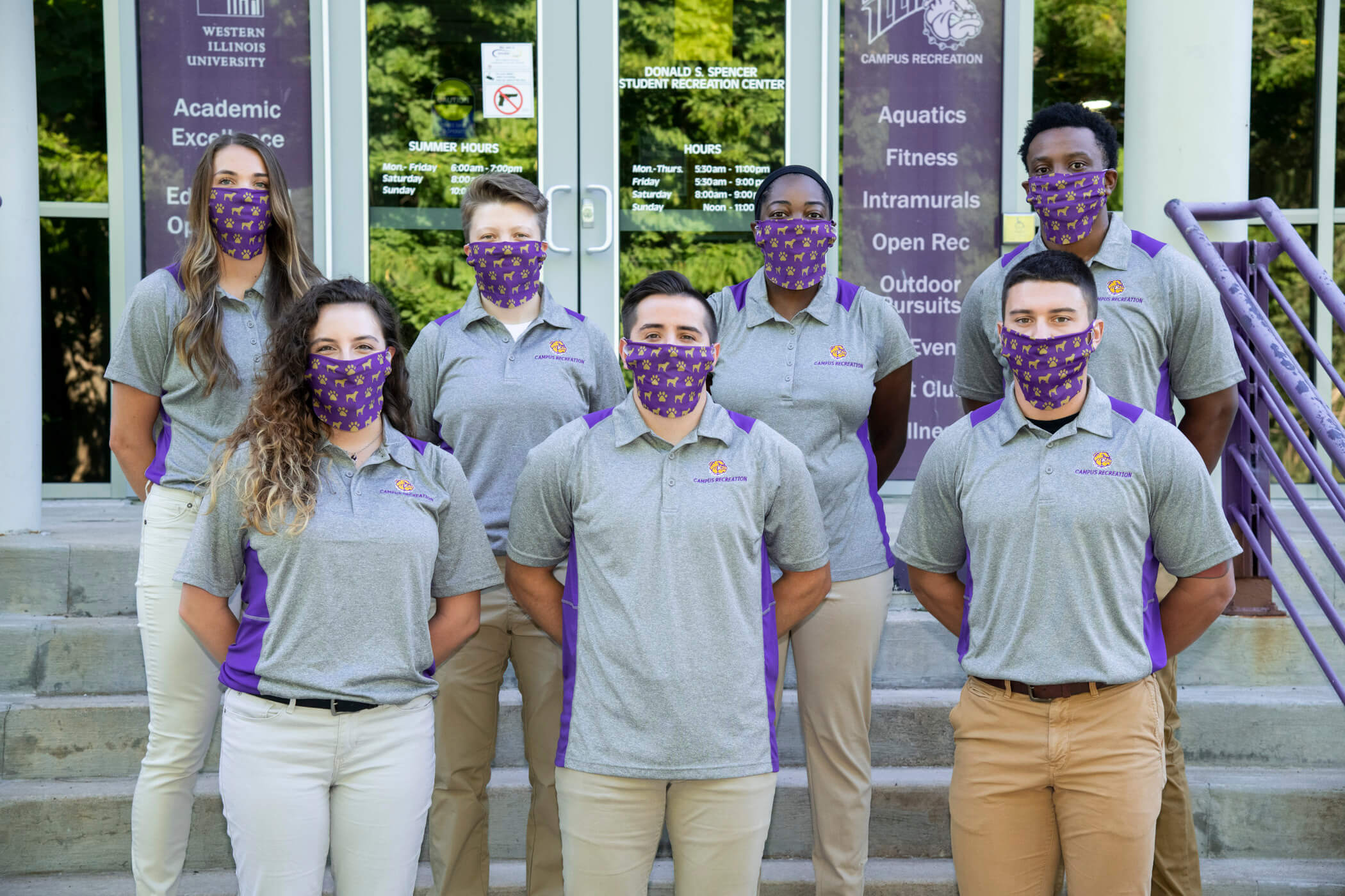 Photo of Fall 2020 Graduate Assistants standing on steps wearing masks