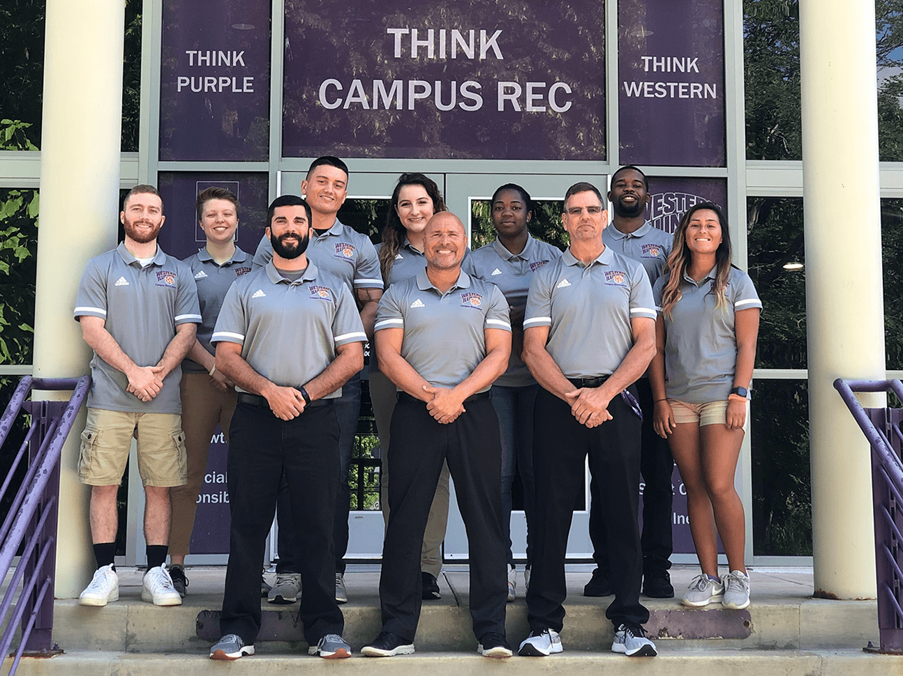 Campus Rec staff photo in front of the rec center.