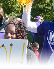Third section of a panoramic photo of student's holding a handmade sign, PURPLE GOLD