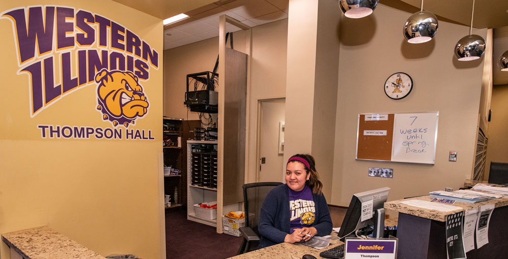 Thompson Hall Facilities with a student sitting at a desk.JPG
